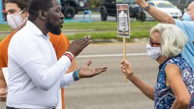 Dueling mask mandate rallies prompt police response ahead of Lake County School Board meeting