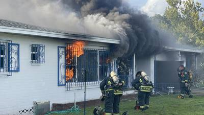 Photos: Orlando firefighter injured helping 2 people escape from house fire Sunday