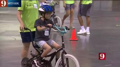 Local non-profit joins with summer camp to teach people with Down Syndrome, autism how to ride bikes