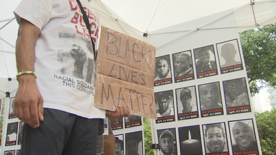 Vigil held in Orlando to call for national, local law enforcement reforms