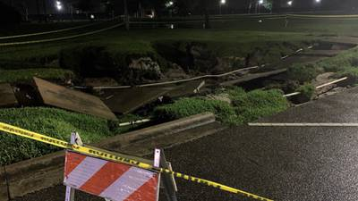 Video: Record rainfall leads to flash floods, large washout in Sanford