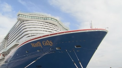 Video: Carnival Cruise Line pops the champagne while christening new Mardi Gras cruise ship