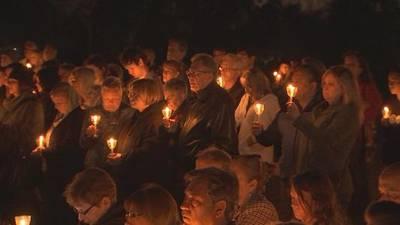 Community gathers for candlelight vigil to honor slain Celebration family